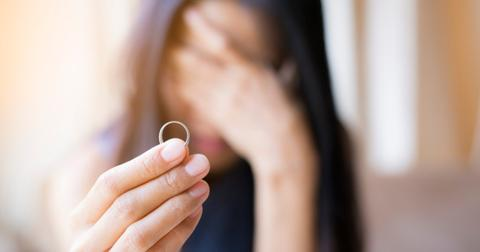 the-woman-holds-the-wedding-ring-and-weeps-she-was-abandoned-by-her-picture-id855007282-1553002010341.jpg