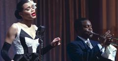 Jazz singer Billie Holiday singing in front of a live audience.