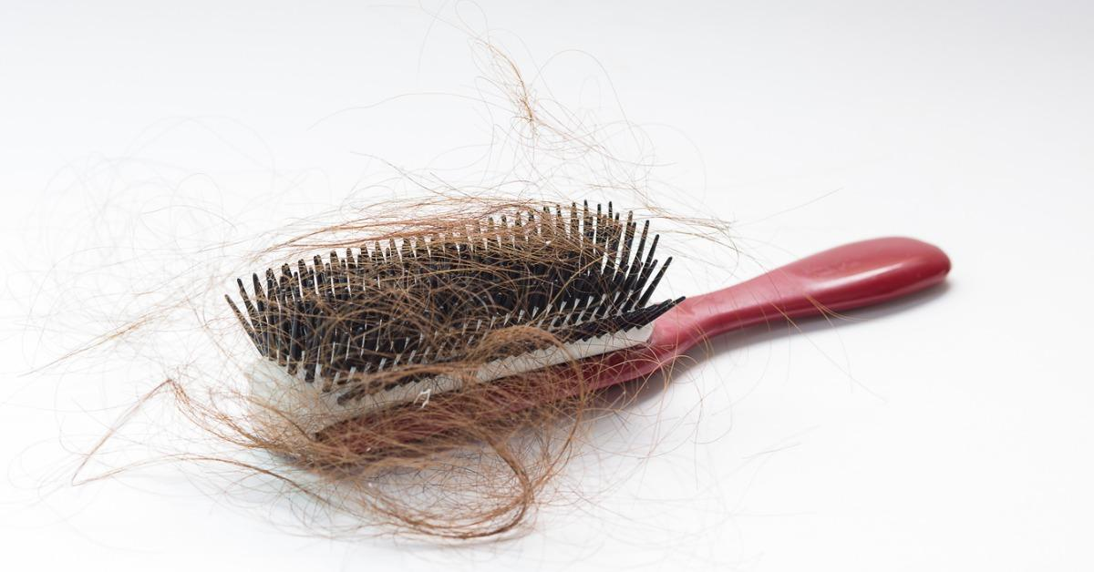 hair-fall-on-a-red-comb-isolated-on-white-background-picture-id476968982-1535049858921-1535049860708.jpg