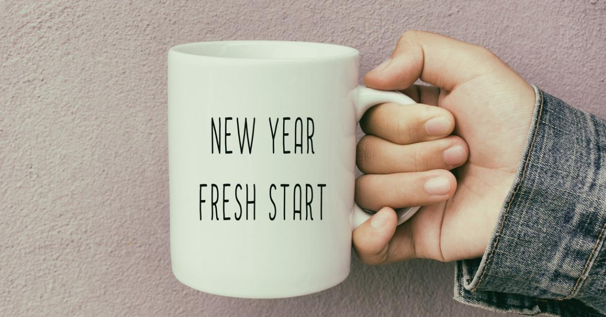 hands-holding-a-coffee-mug-with-text-new-year-fresh-start-picture-id880766334-1541613154119-1541613156231.jpg