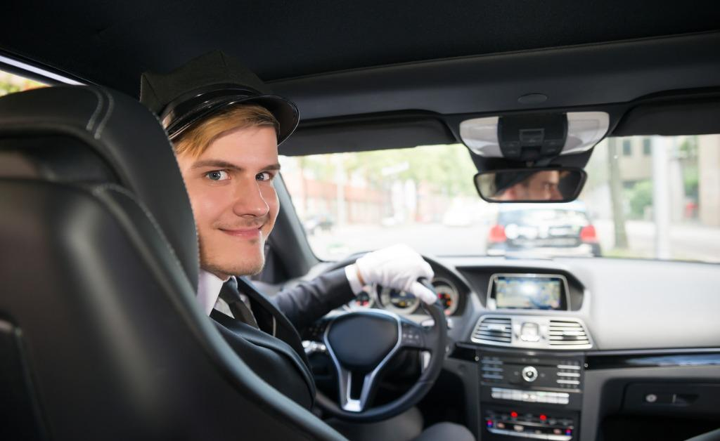 portrait-of-smiling-young-chauffeur-in-car-picture-id847832774-1536603722394-1536603724325.jpg