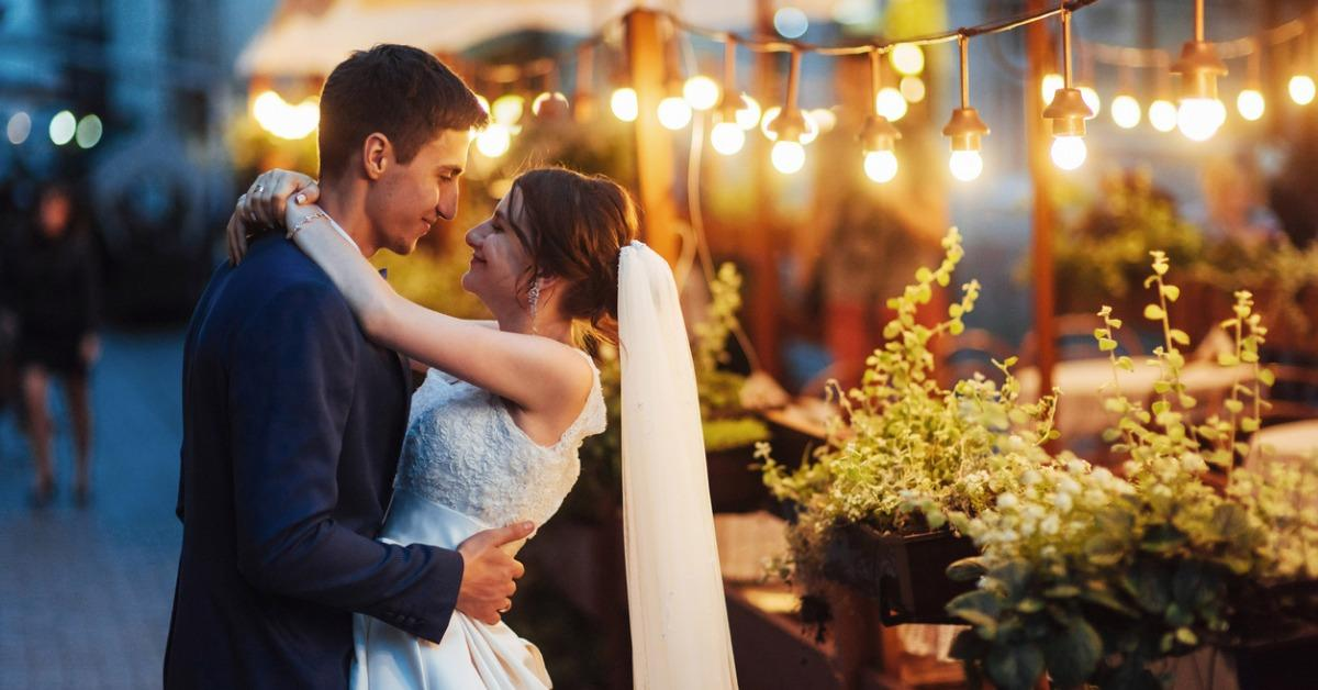 wedding-couple-at-night-lighting-cafe-along-with-decoration-lig-picture-id645075714-1535404418523-1535404420405.jpg