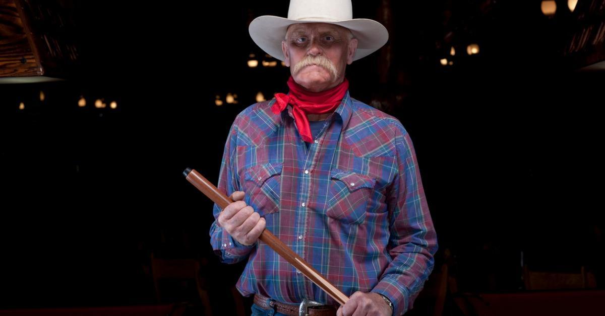senior-cowboy-holding-pool-cue-picture-id119098754-1534348671968-1534348673594.jpg