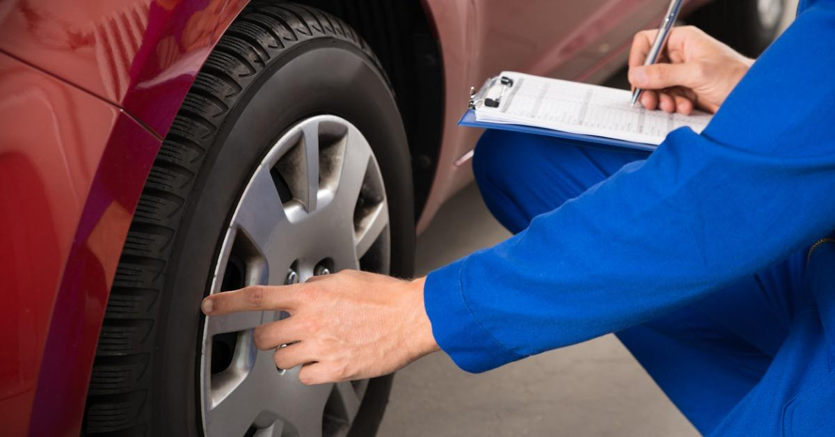 mechanic-examining-car-wheel-picture-id618519320-1540299237738-1540299239271.jpg