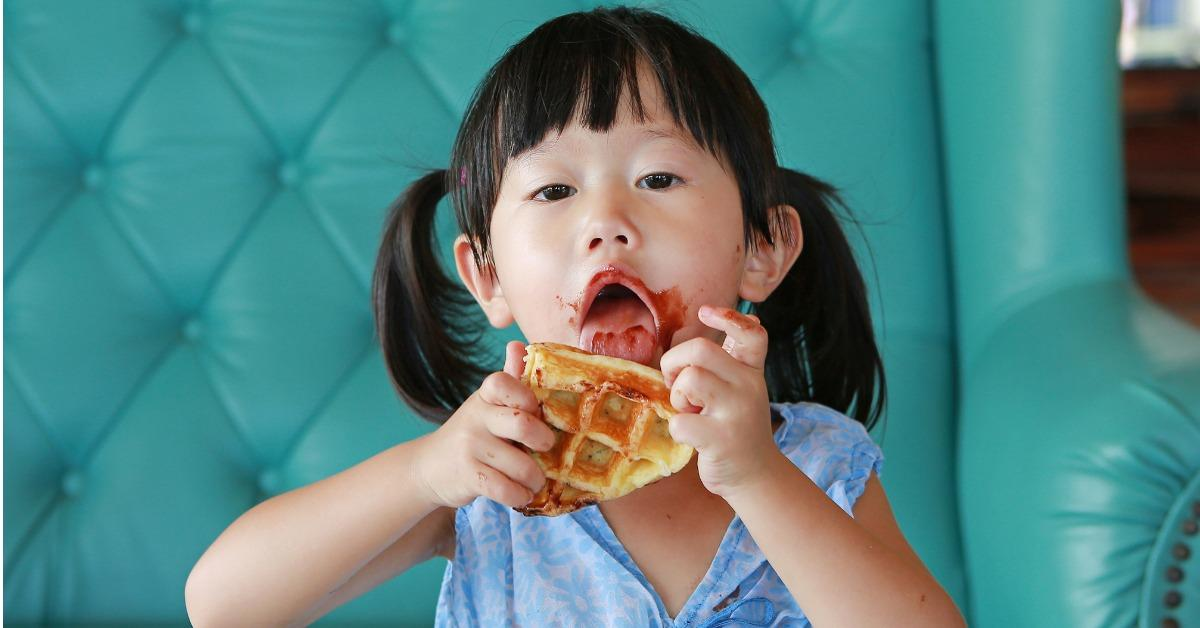 portrait-child-girl-eating-ice-cream-waffles-picture-id850629690-1540403284302-1540404034575.jpg