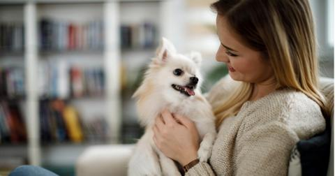 woman-relaxing-at-home-with-her-dog-picture-id943315926-1561127752808.jpg