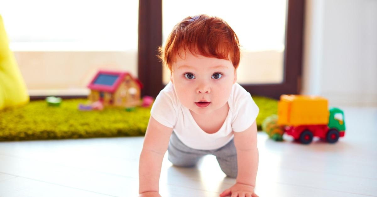 cute-toddler-baby-crawling-on-the-floor-at-home-picture-id925084908-1535135944518-1535135946454.jpg