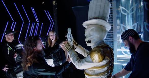 masked-singer-skeleton-microphone-1568733716581.jpg