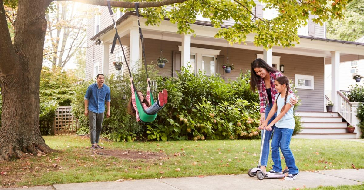children-playing-on-garden-swing-and-scooter-outside-house-picture-id905902050-1548365227050.jpg