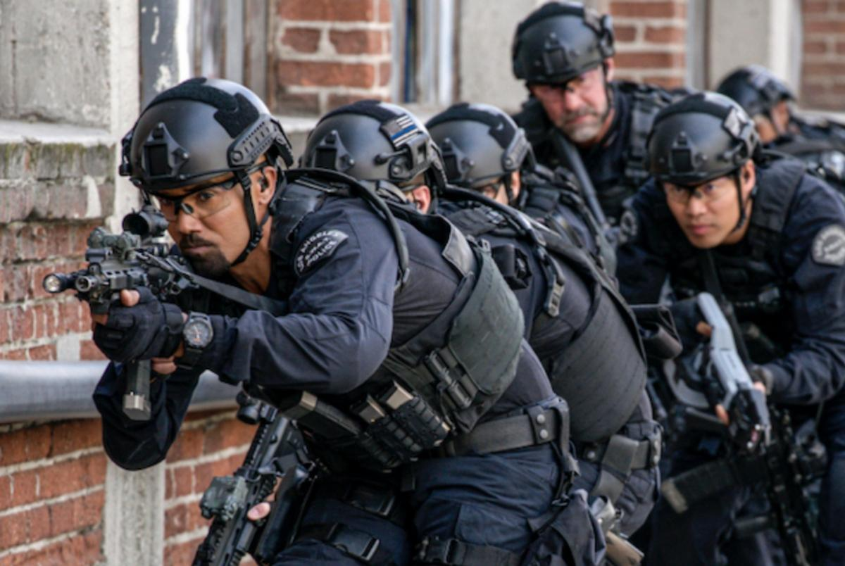 'S.W.A.T' officers entering a building to get the bad guys.