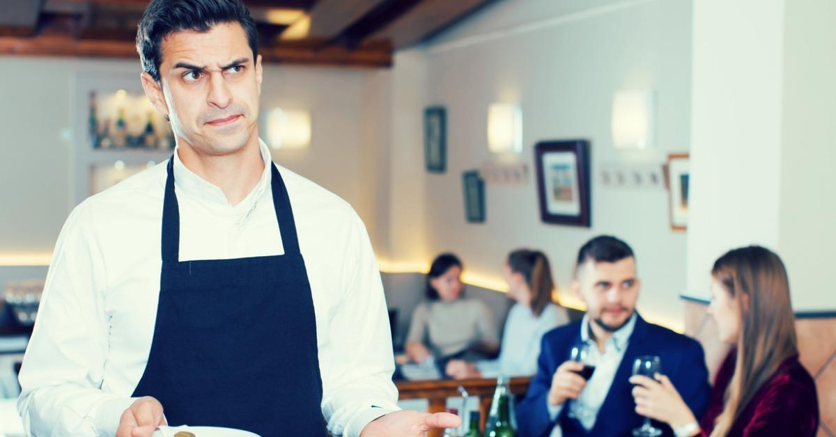 waiter-dissatisfied-with-small-tip-from-cafe-visitors-picture-id959938242-1542656734008-1542656735989.jpg
