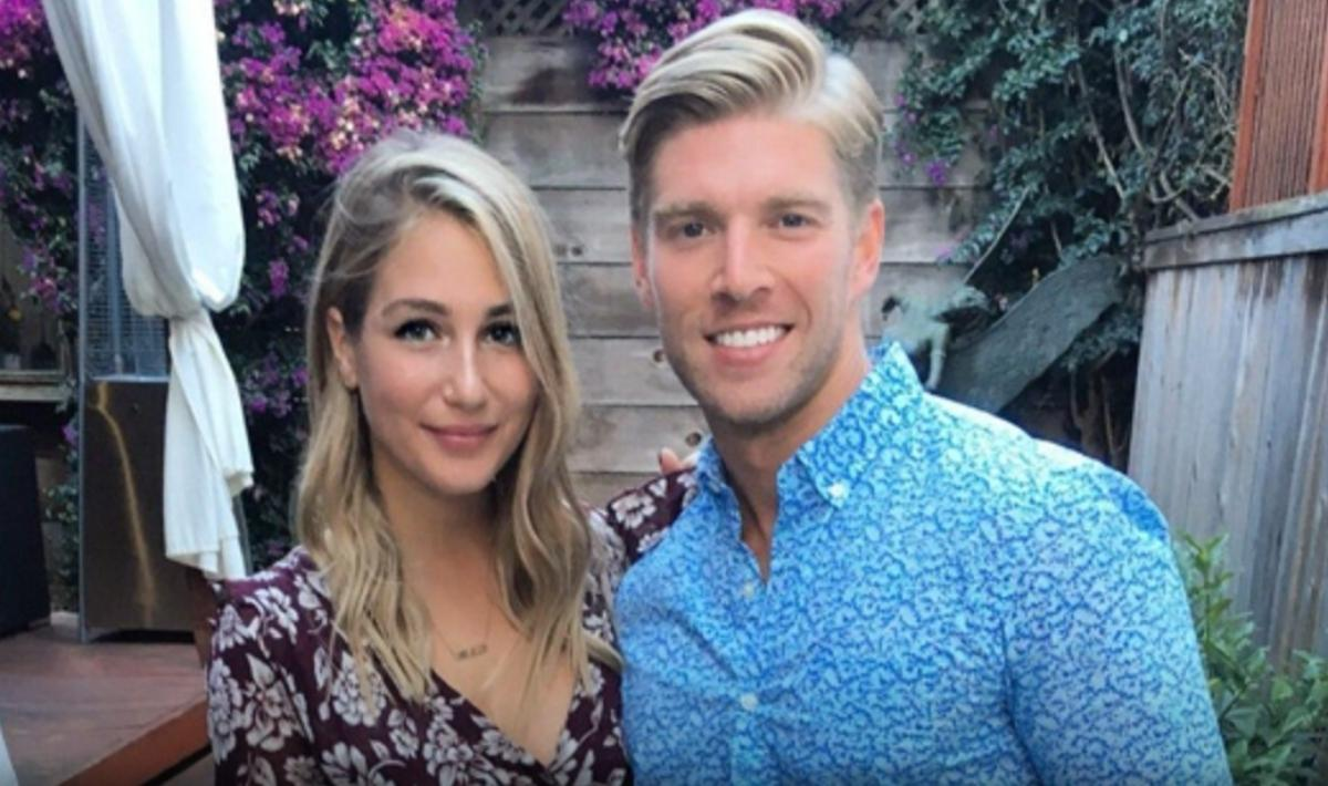 Amanda and Kyle at their engagement party with friends,