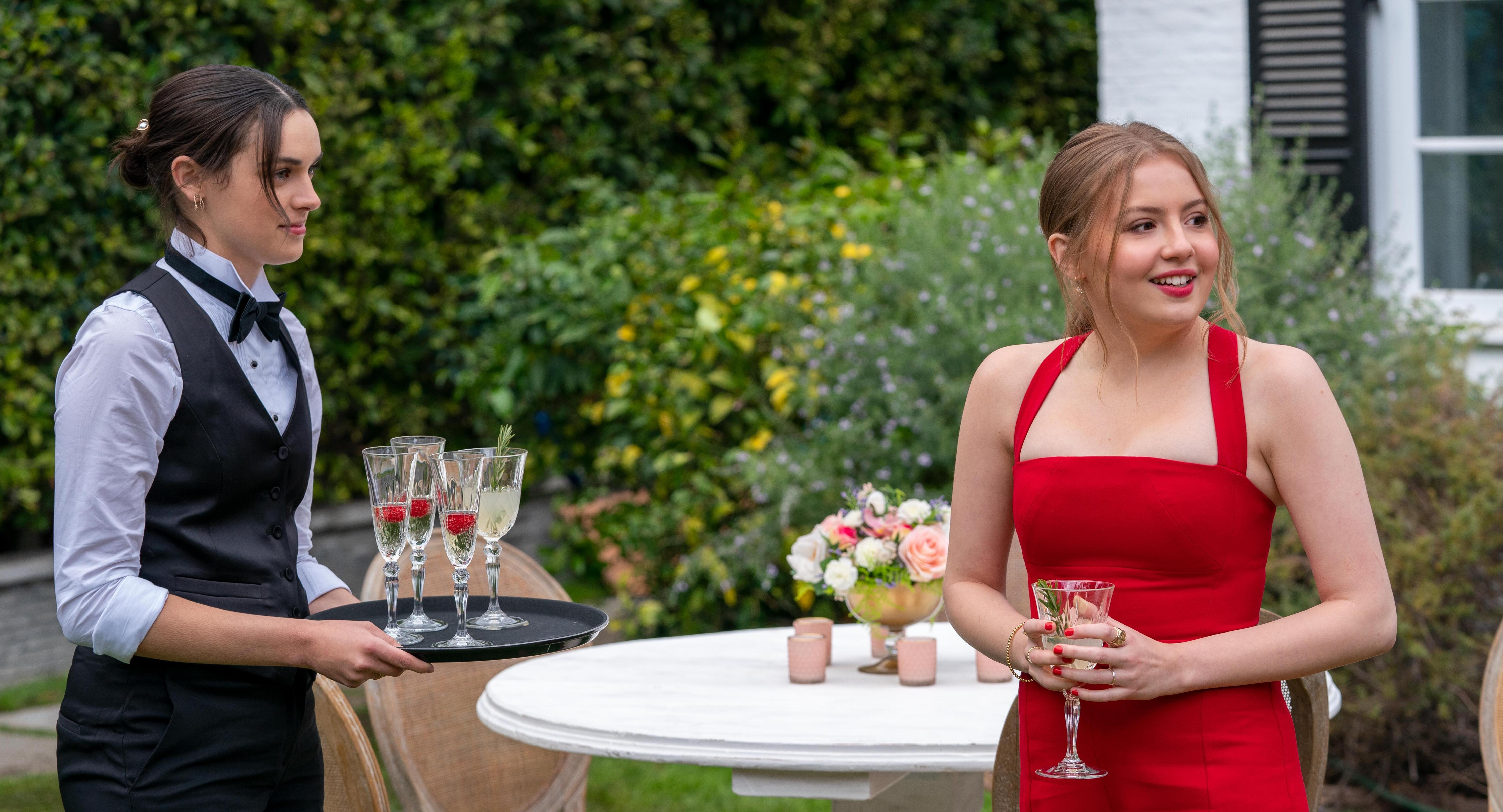 Lake and Lucy talking at the wedding in 'Love, Victor' Season 2
