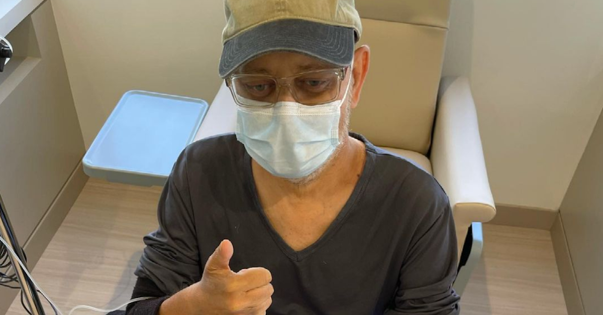 James Michael Tyler gives a thumbs up with a mask on after chemo