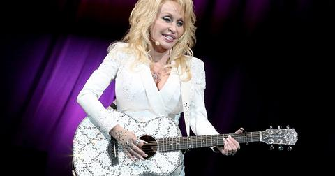 dolly-parton-gloves-hands-1573670859417.jpg