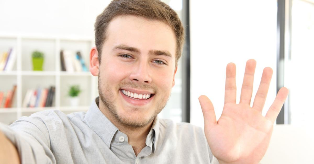 man-waving-on-a-video-call-at-home-picture-id903242776-1540404019746-1540404038354.jpg