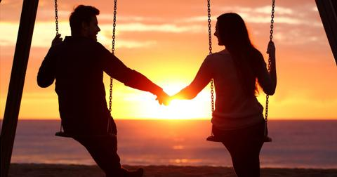 couple-silhouette-holding-hands-watching-a-sunrise-picture-id623211552-1553190628622.jpg