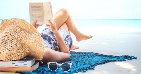 woman-reading-a-book-on-the-beach-in-free-time-summer-holiday-picture-id942466852-1553780773758.jpg