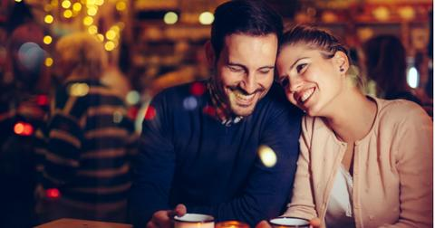 romantic-couple-dating-in-pub-at-night-picture-id1058684894-1561127760407.jpg