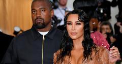 Kanye West and Kim Kardashian pose for a photo.