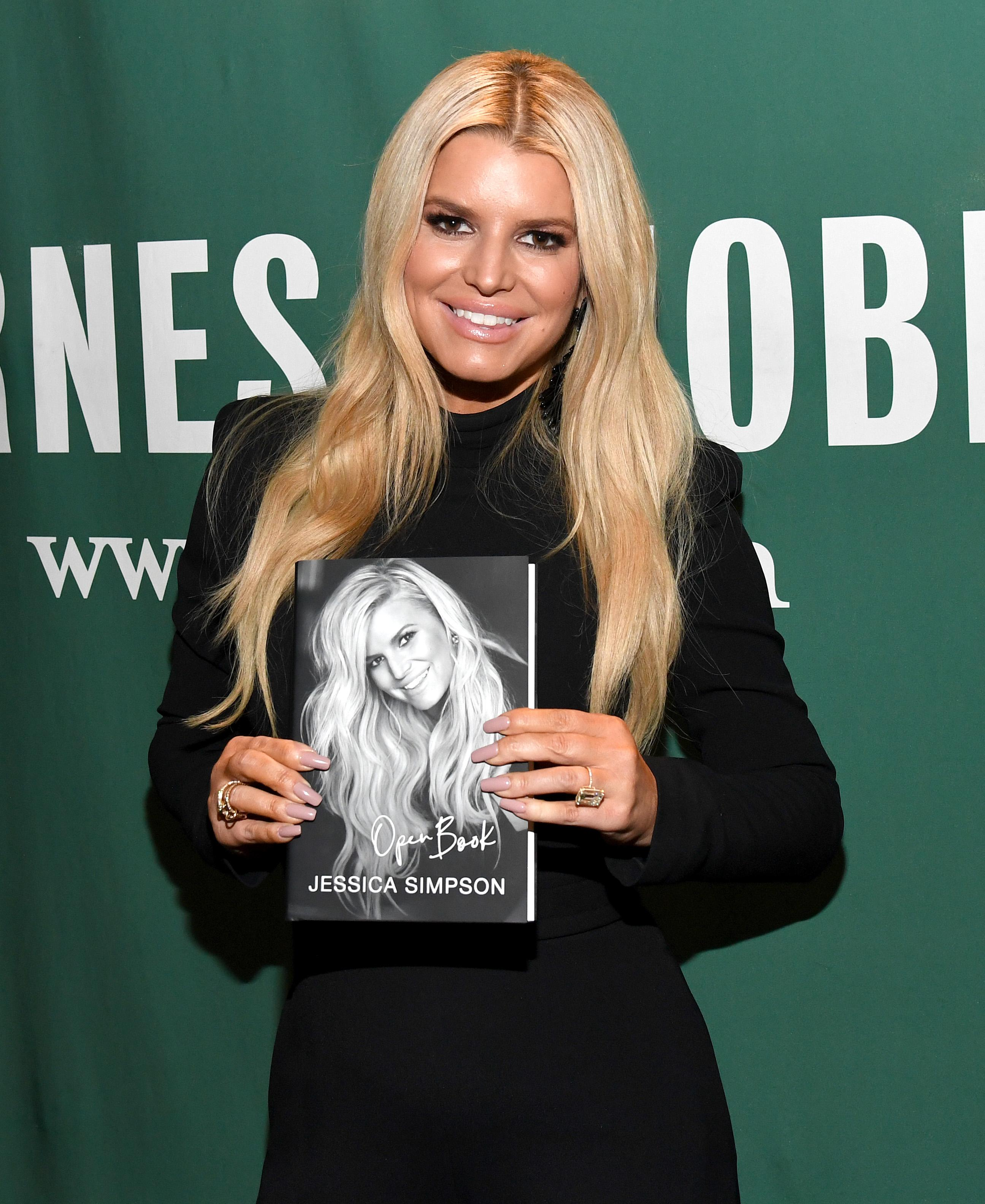 jessica-simpson-new-songs-open-book-1580930007101.jpg