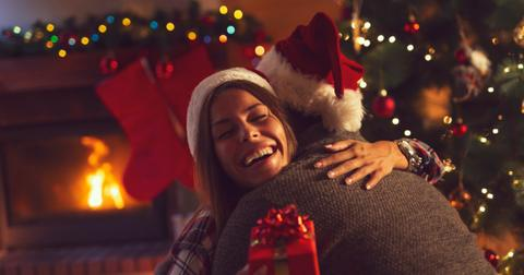 couple-exchanging-christmas-presents-picture-id1043577006-1552593353090.jpg