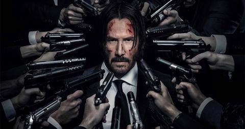 john-wick-guns-on-him-1558105457956.jpg