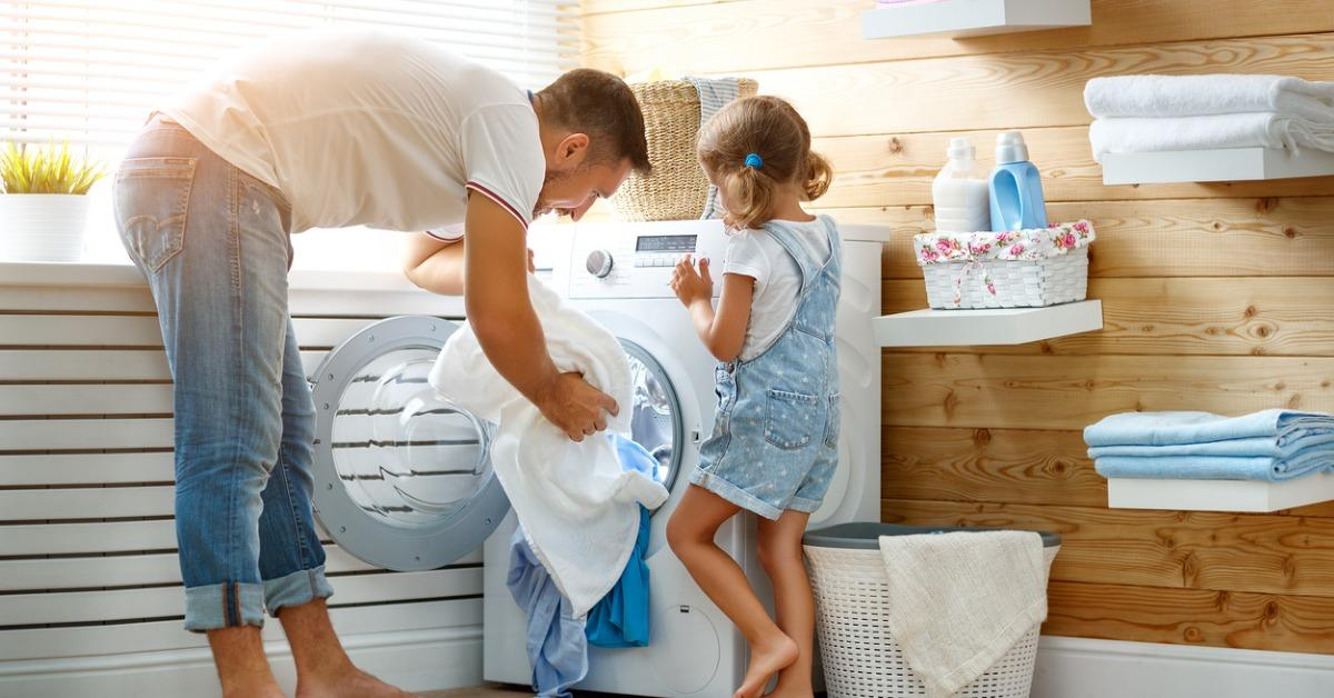 happy-family-man-father-householder-and-child-in-laundry-with-washing-picture-id880308374-1540407185303-1540407187487.jpg