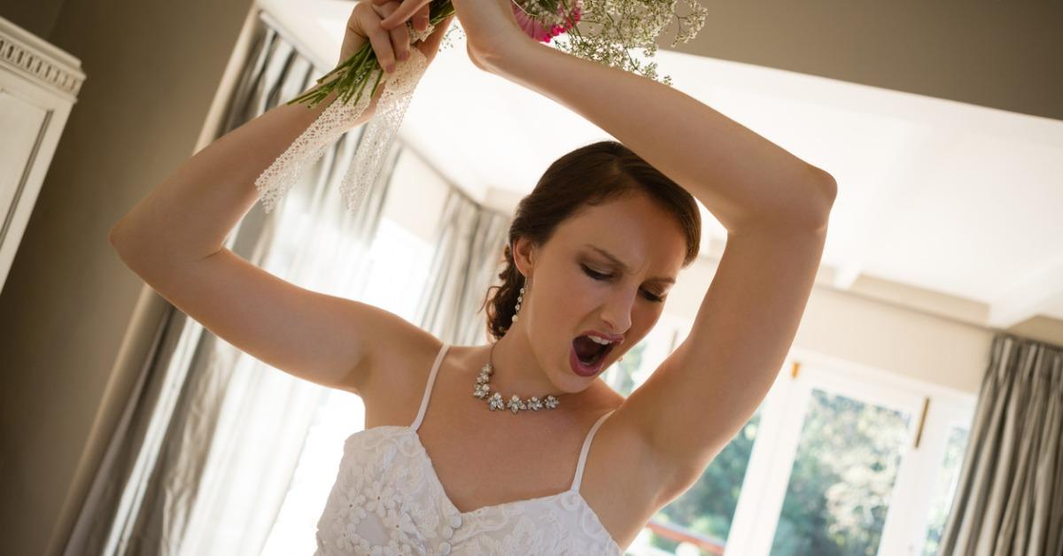 tilt-image-of-angry-bride-throwing-bouquet-at-home-picture-id846573206-1546016417748.jpg
