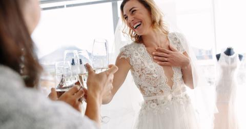 bride-toasting-champagne-with-friends-in-bridal-boutique-picture-id912234788-1552593428814.jpg