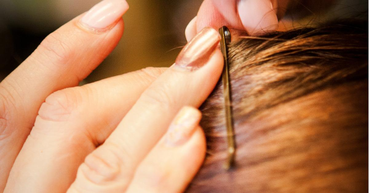 hairdresser-stylist-adds-bobby-pin-to-hair-wrap-picture-id503942567-1536098245437-1536098247270.jpg