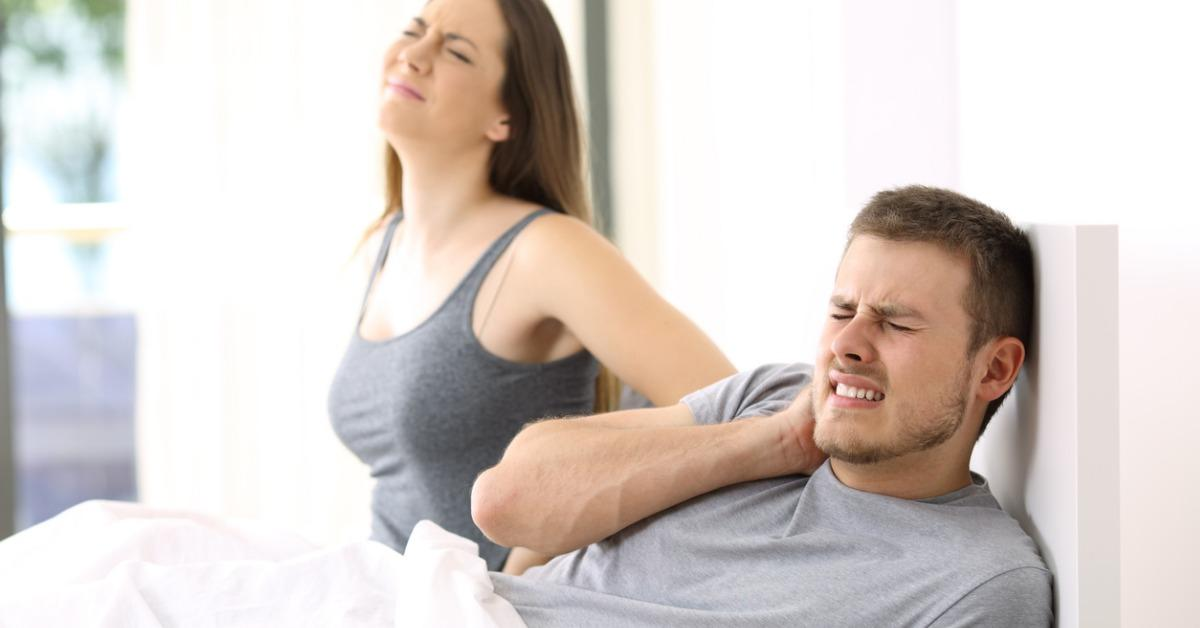 couple-suffering-ache-in-a-not-comfortable-bed-picture-id827906316-1540407303635-1540407509995.jpg