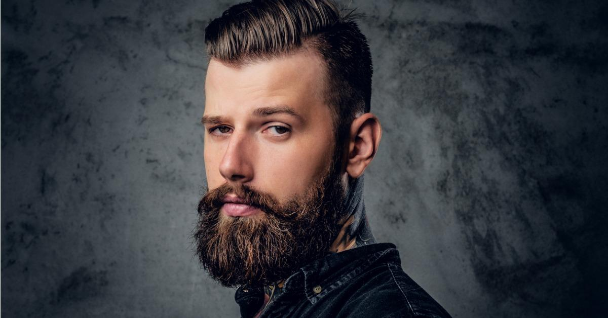 bearded-male-in-black-shirt-with-tattoo-on-his-neck-picture-id918183376-1539961817443-1539962614018.jpg