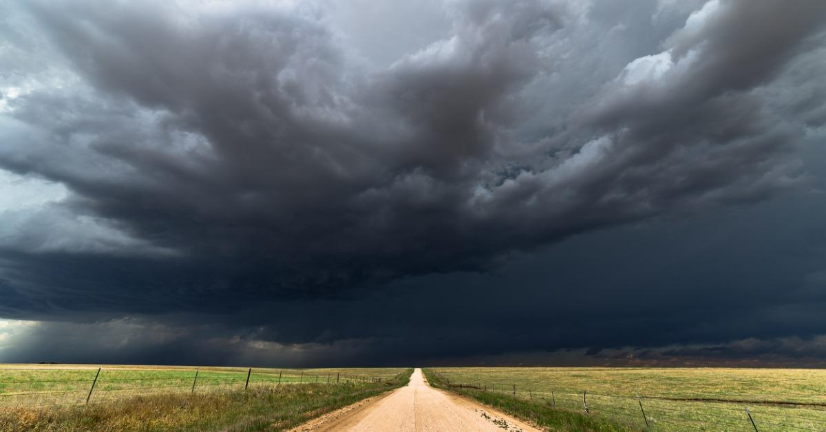 dark-storm-clouds-over-a-dirt-road-picture-id811485572-1534348931866-1534348933699.jpg