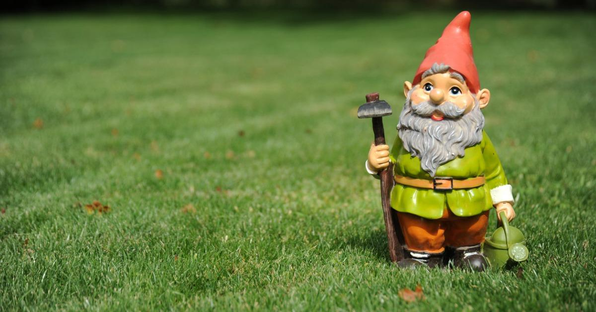 closeup-of-garden-gnome-holding-pickax-and-watering-can-picture-id114452225-1534948840566-1534948842318.jpg