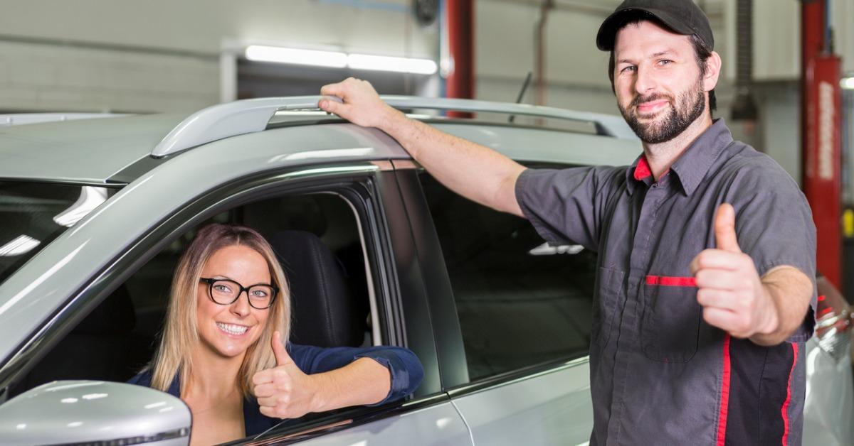 auto-mechanic-and-female-customer-in-garage-picture-id854449934-1540299277236-1540299279006.jpg