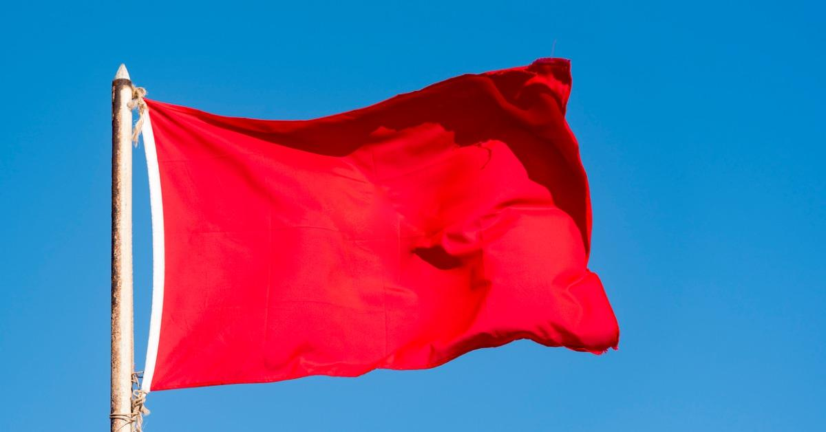 old-red-flag-and-blue-sky-red-banner-waving-against-blue-sky-picture-id908587472-1542298523735-1542298525724.jpg