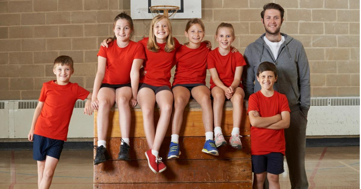 portrait-of-school-gym-team-sitting-on-vaulting-horse-picture-id492259082-1539011593898-1539011596307.jpg