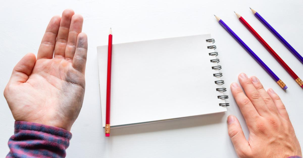 lefthanded-man-shows-a-dirty-hand-after-writing-mockup-picture-id826809758(1)-1538410706573-1538410708439.jpg
