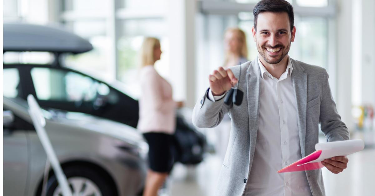 handsome-salesman-at-car-dealership-selling-vehichles-picture-id882991434-1539714359639-1539714396841.jpg