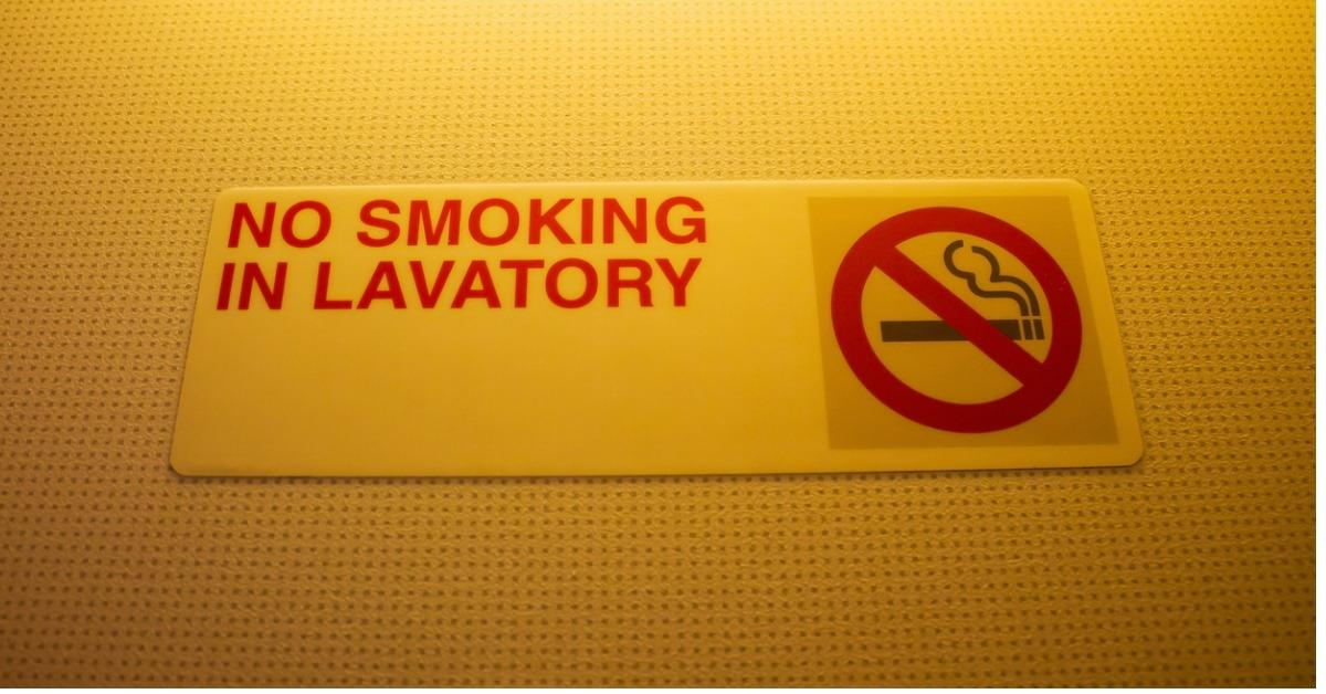 no-smoking-in-lavatory-sign-warning-in-toilet-on-airplane-picture-id509736982-1534795508396-1534795510511.jpg