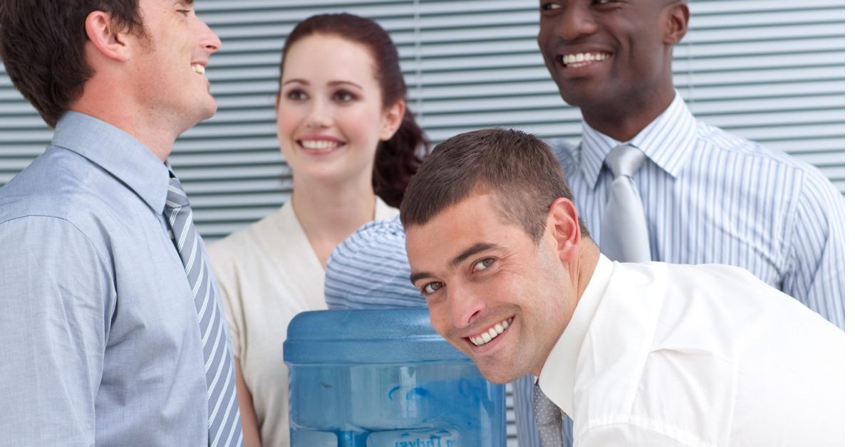 business-colleagues-talking-around-water-cooler-picture-id96925612-1538410755325-1538410757335.jpg
