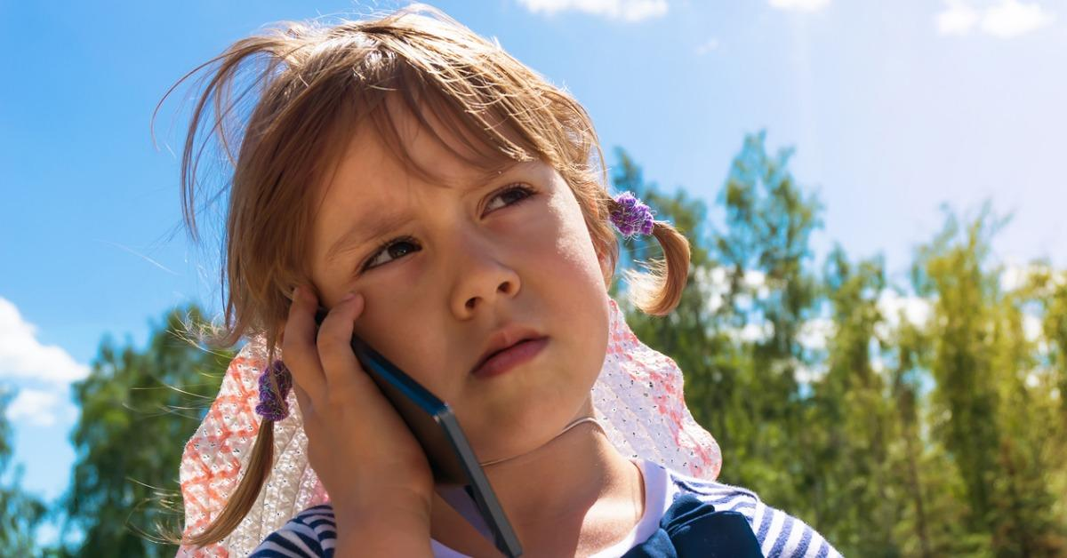 little-girl-looking-up-and-speaking-by-cell-phone-picture-id823671888-1540495844562-1540495846476.jpg