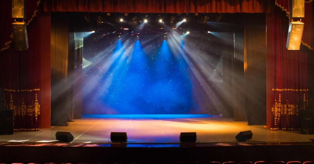an-empty-stage-of-the-theater-lit-by-spotlights-and-smoke-picture-id824977326-1534945825825-1534945827838.jpg