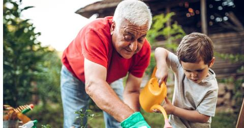 grandfather-and-grandson-in-garden-picture-id971388782-1558539476065.jpg