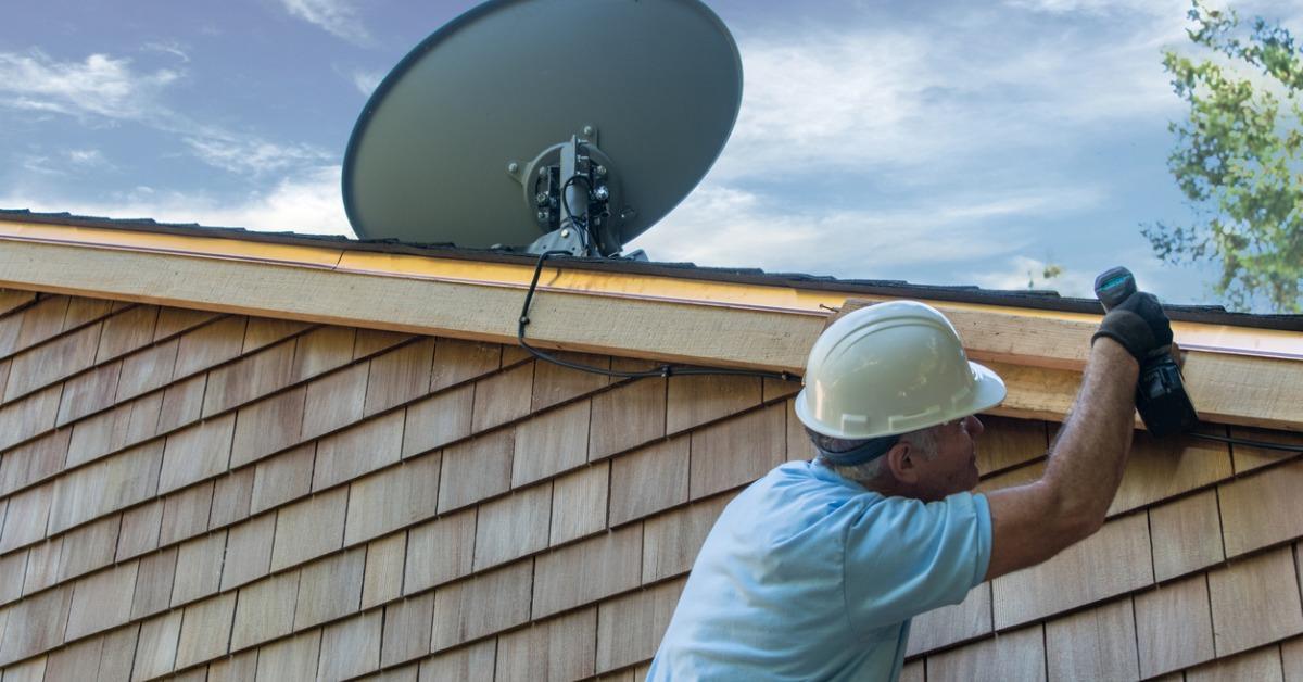 man-installing-satellite-dish-picture-id1022086194-1548444946549.jpg