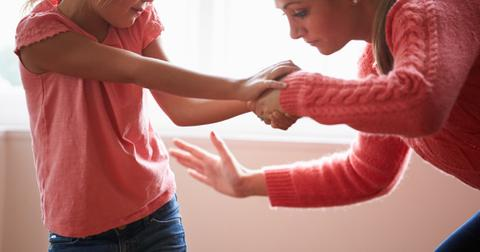 mother-in-pink-smacking-young-daughter-picture-id466347619-1553539129423.jpg
