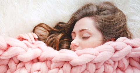 young-woman-with-long-brown-hair-sleeping-under-warm-knitted-peach-picture-id881280596-1552055407812.jpg