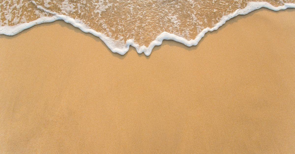 wave-on-the-sand-beach-background-picture-id469421218-1534946092836-1534946094600.jpg
