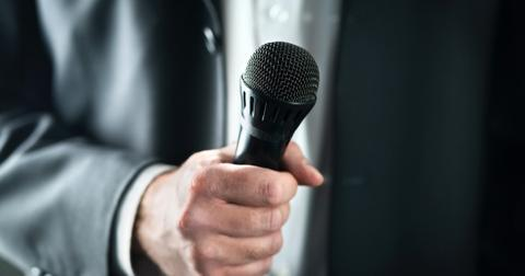 business-man-holding-microphone-public-speaking-and-giving-speech-in-picture-id1124732940-1552400904027.jpg